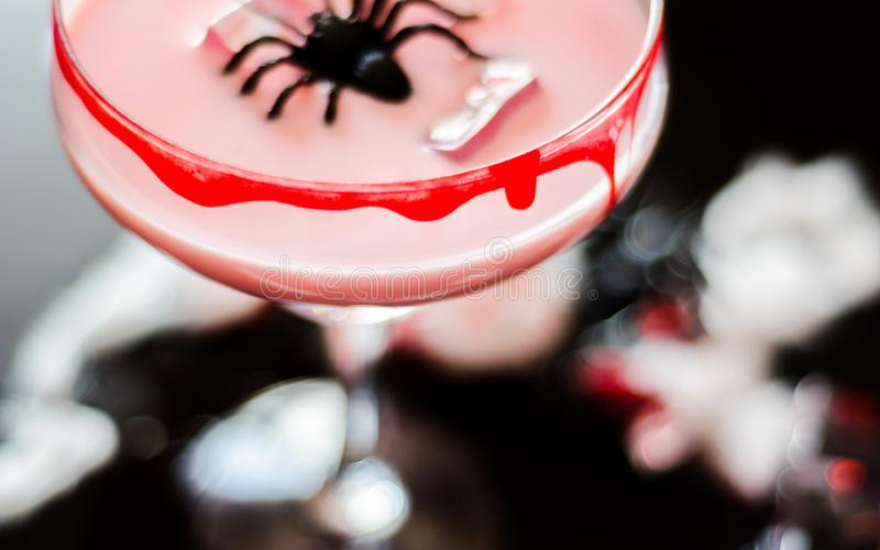 Creepy halloween party cocktails with blood, spiders and ice cub royalty free stock photos