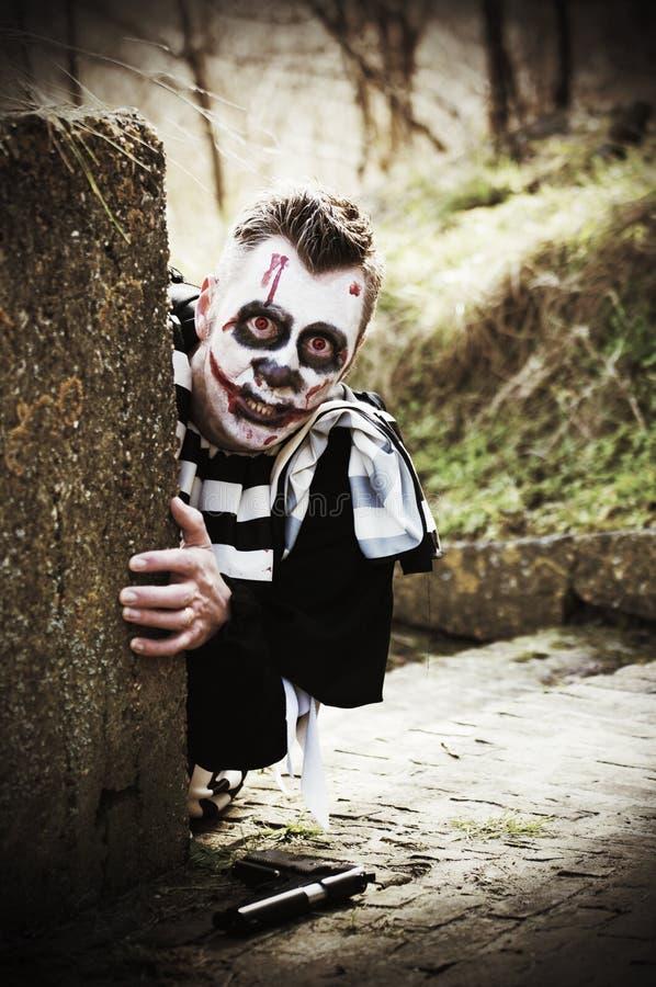 Creepy horror clown stock images