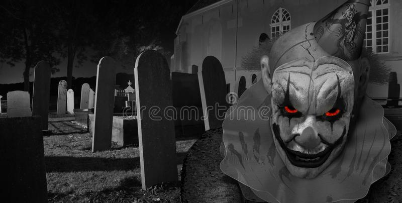 Creepy horror clown in graveyard. Horror clown staring at you in Graveyard a at night