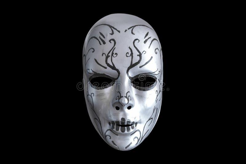 Creepy mask on the black background royalty free stock image