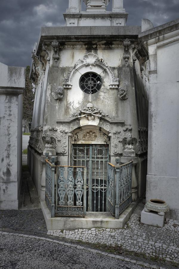 Creepy old cemetery tomb. Creepy old european cemetery family tomb royalty free stock photos