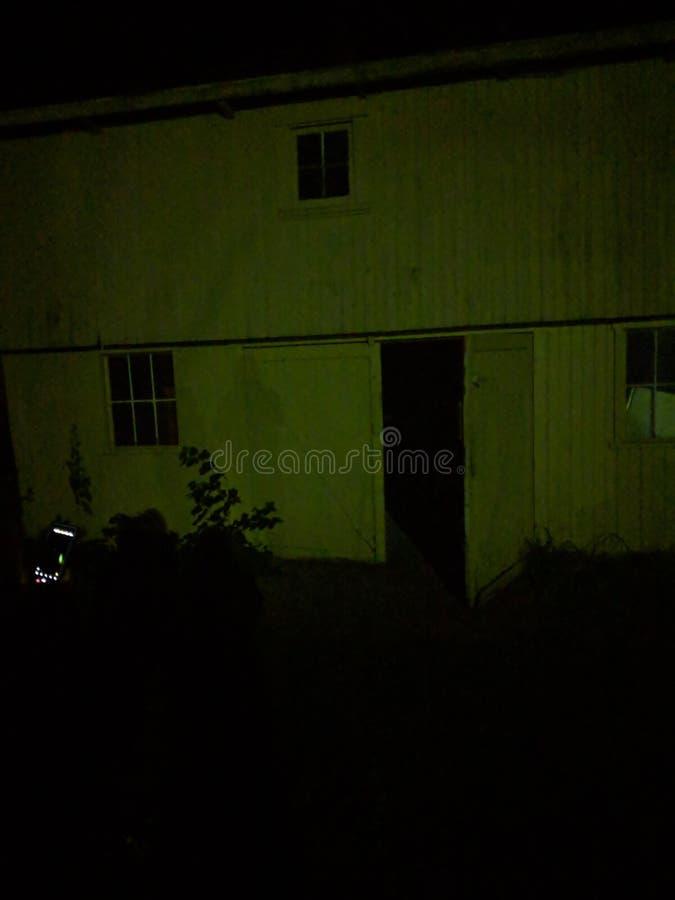 Creepy shed at night stock photos
