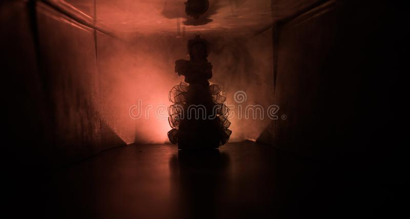 Creepy silhouette in the dark abandoned building. Horror about maniac concept or Dark corridor with cabinet doors and lights with. Silhouette of spooky horror royalty free stock images