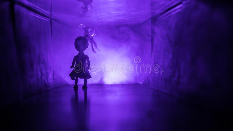 Creepy silhouette in the dark abandoned building. Horror about maniac concept or Dark corridor with cabinet doors and lights with. Silhouette of spooky horror stock photos