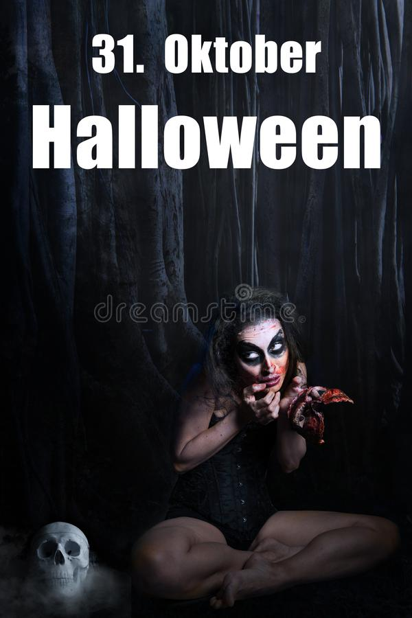 Creepy woman with a bloody face in her hands and the message `31. October Halloween`. Date in German royalty free stock photography