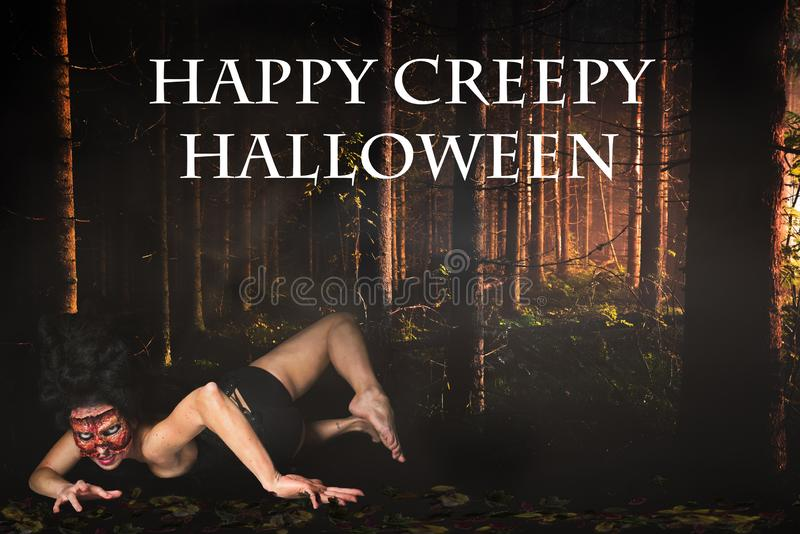 Creepy woman in the forest and the message `Happy Creepy Halloween`. Creepy woman missing face in the forest and the message `Happy Creepy Halloween royalty free stock images