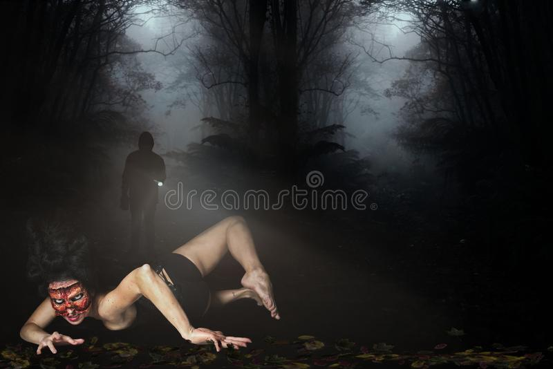 Creepy woman missing face in the forest. Creepy woman with a missing face in the forest stock image