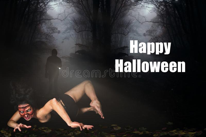 Creepy woman missing face in the forest and the message `Happy Halloween`. Creepy woman with missing face in the forest and the message `Happy Halloween stock photo