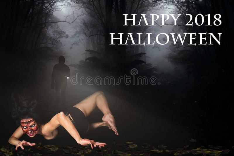 Creepy woman in the forest and the message `Happy 2018 Halloween`. Creepy woman missing face in the forest and the message `Happy 2018 Halloween stock photo