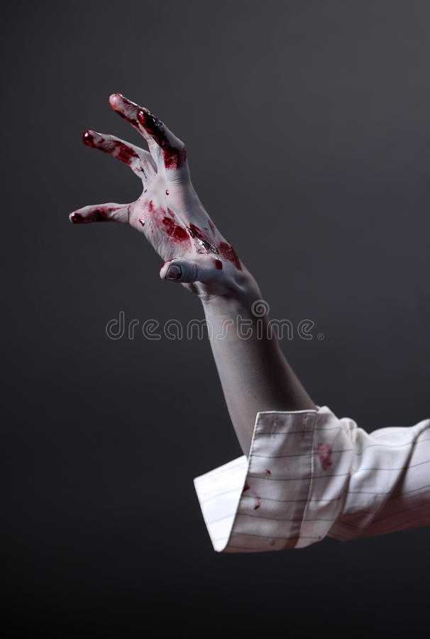 Creepy zombie hand, extreme body-art stock photo