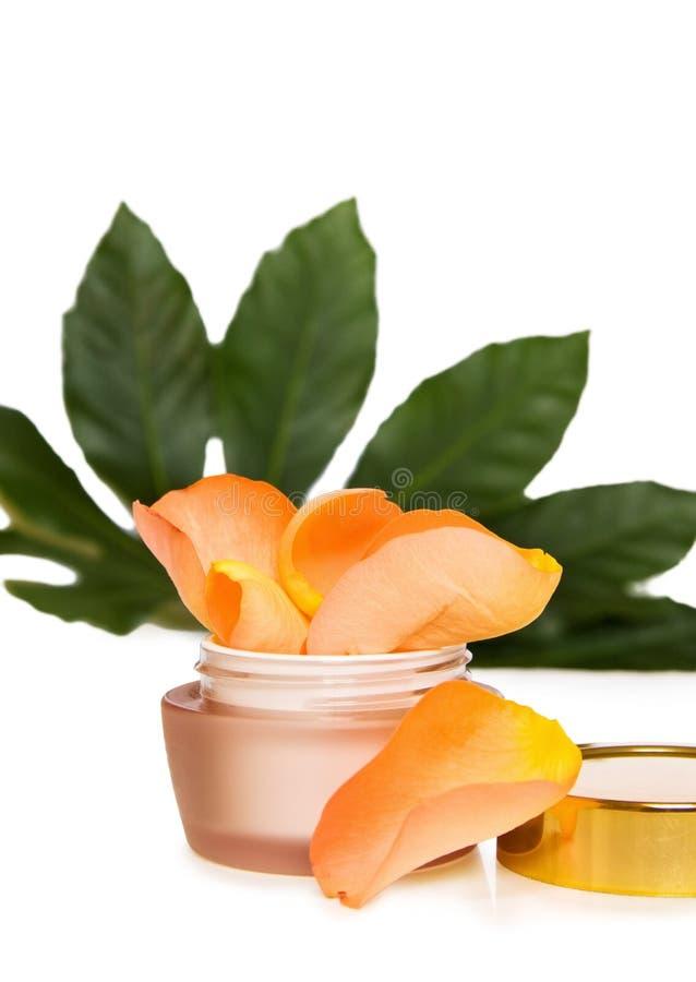 Crema hidratante de lujo de la cara con las rosas imágenes de archivo libres de regalías