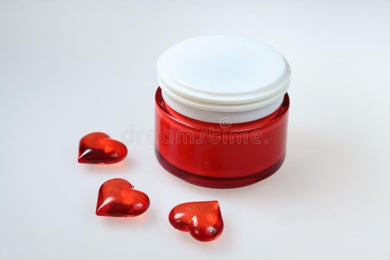 Crema per pelle e la decorazione di amore fotografia stock
