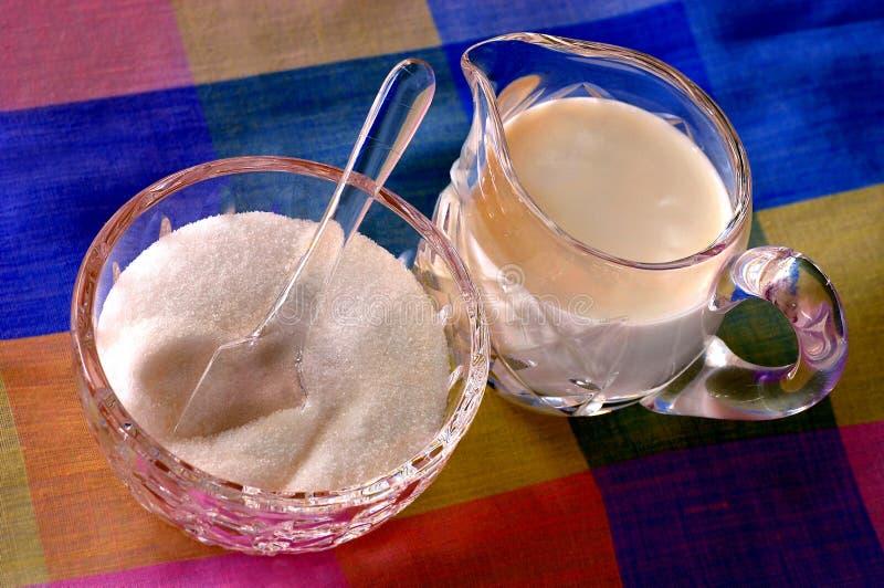 Crema y azúcar fotografía de archivo