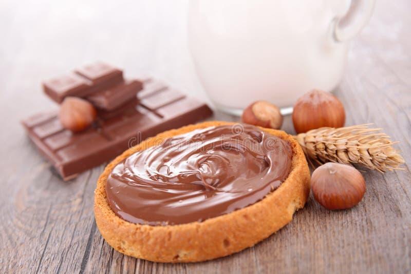 Crema y pan del chocolate fotografía de archivo