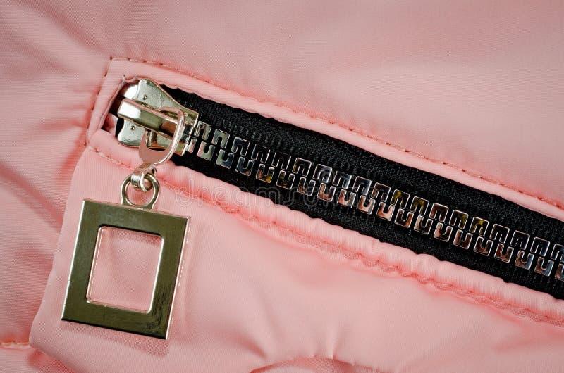 Cremallera en el bolsillo de la chaqueta rosada para los niños foto de archivo