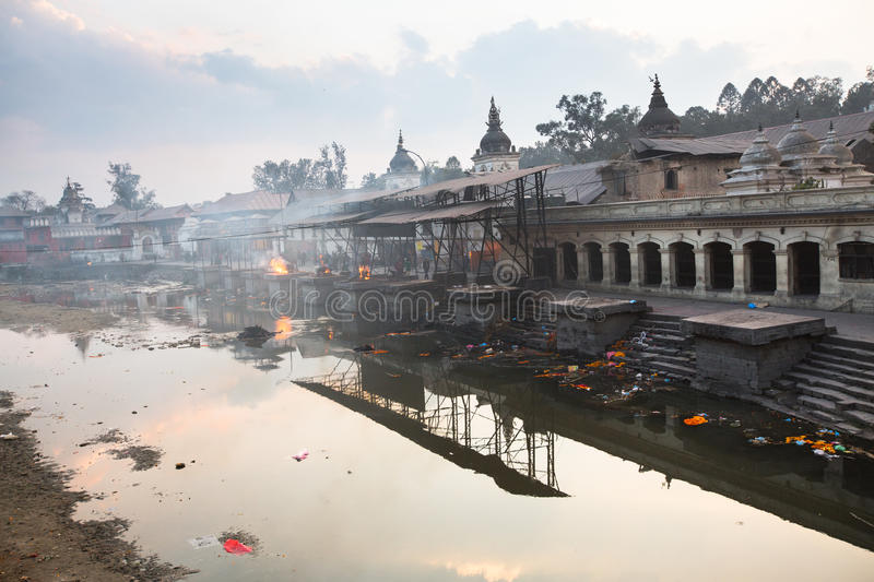 During the cremation ceremony along the holy Bagmati River in Bhasmeshvar Ghat at Pashupatinath temple. KATHMANDU, NEPAL - DEC 20: During the cremation ceremony stock photo