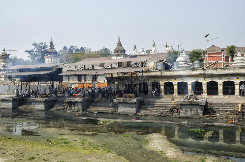 The cremation ceremony along the holy Bagmati River in Bhasmeshvar Ghat at Pashupatinath temple in Kathmandu. stock image