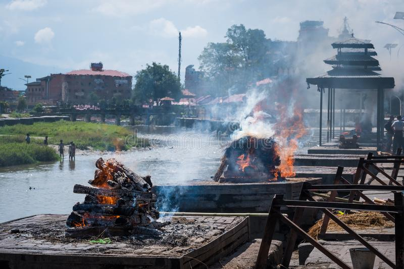 Pashupatinath temple cremations on the Bagmati River. Cremation ceremony at Pashupatinath temple on the Bagmati River royalty free stock image