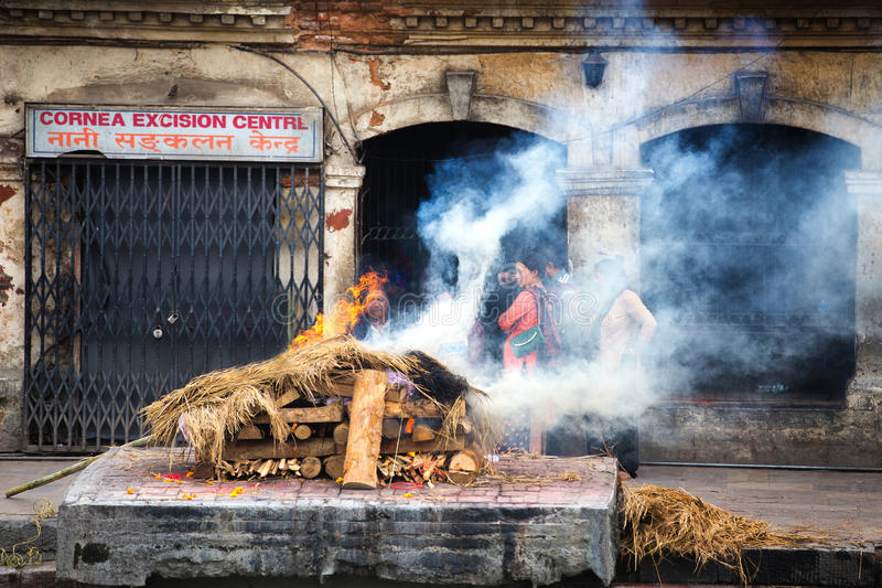 Cremation ceremony at Pashupatinath Temple. Hindu Cremations at Pashupatinath Temple in Kathmandu Nepal royalty free stock photo