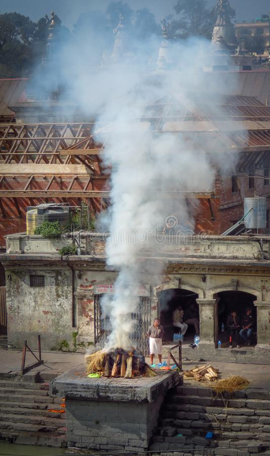 Cremation at Pashupatinath Hindu Temple, Kathmandu, Nepal. Kathmandu, Nepal - 11/14/2017: Cremation at Pashupatinath Hindu Temple royalty free stock photo
