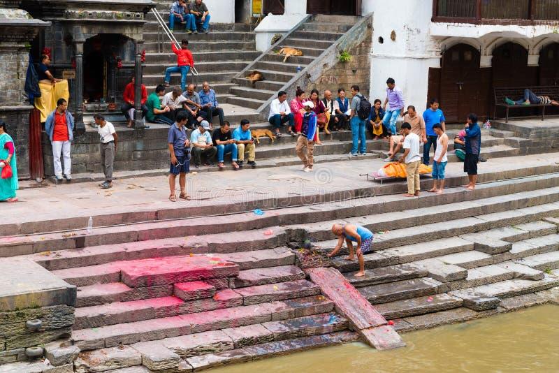 Cremation ritual at Pashupatinath Hindu Temple complex near Kathmandu, Nepal royalty free stock images