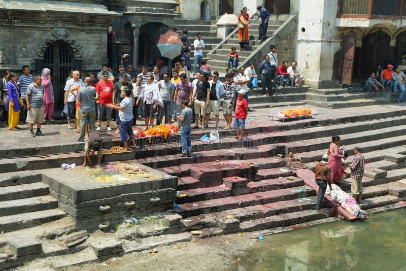 Cremation in sacred Hindu temple dedicated to Pashupatinath in Kathmandu, Nepal. royalty free stock photo