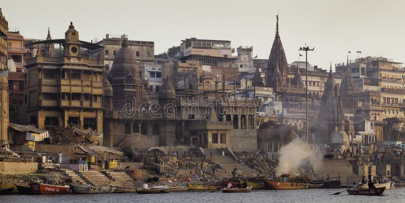 A Cremation Takes Place on the River Ganga. Manikarnika Ghat is one of the holiest among the sacred riverfront, alongside the river Ganga. It is believed that a stock photo