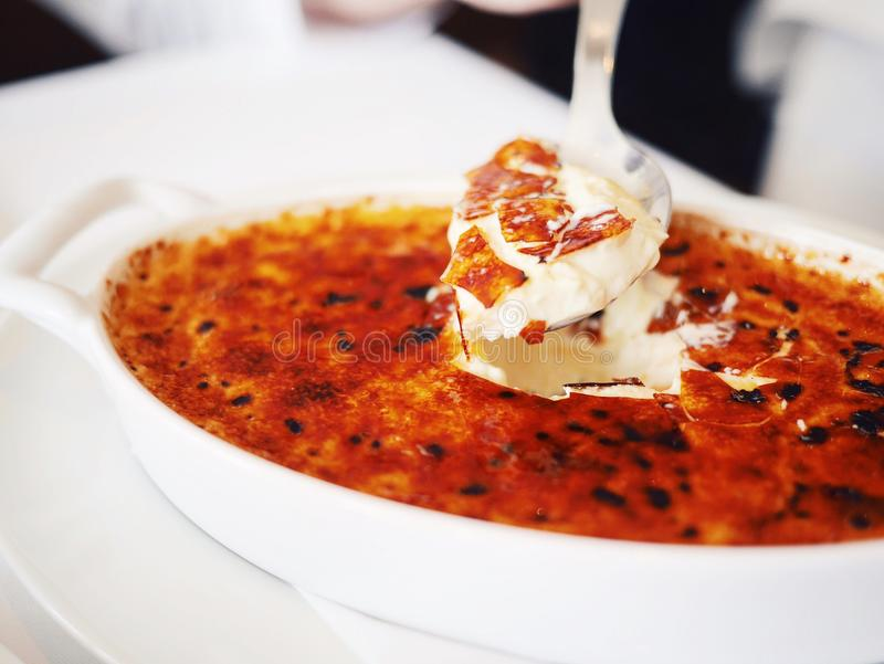 Creme Brulee cracked with a spoon stock images