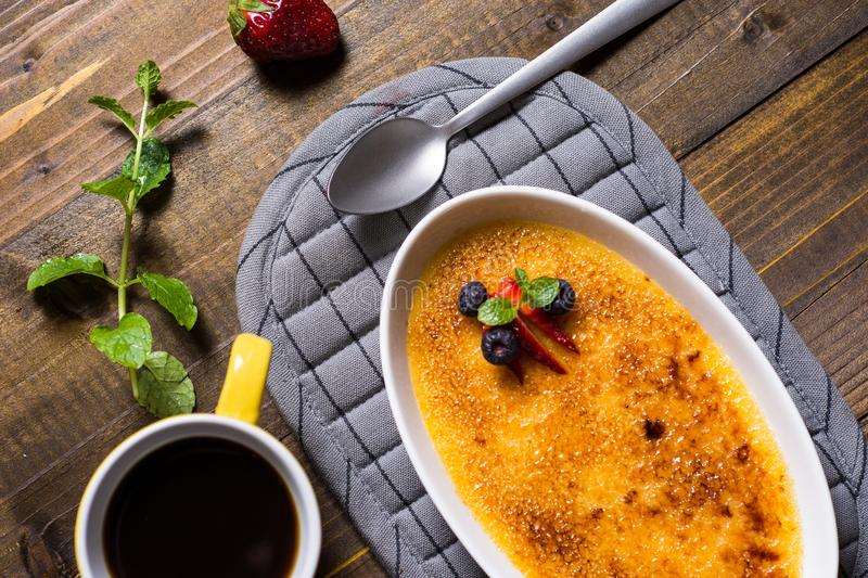 Creme Brulee Dessert with Caramelised Sugar, Strawberry, Blueberry and Fresh Mint Leaves. Sweet Creme Brulee Dessert with Caramelised Sugar, Strawberry stock photos