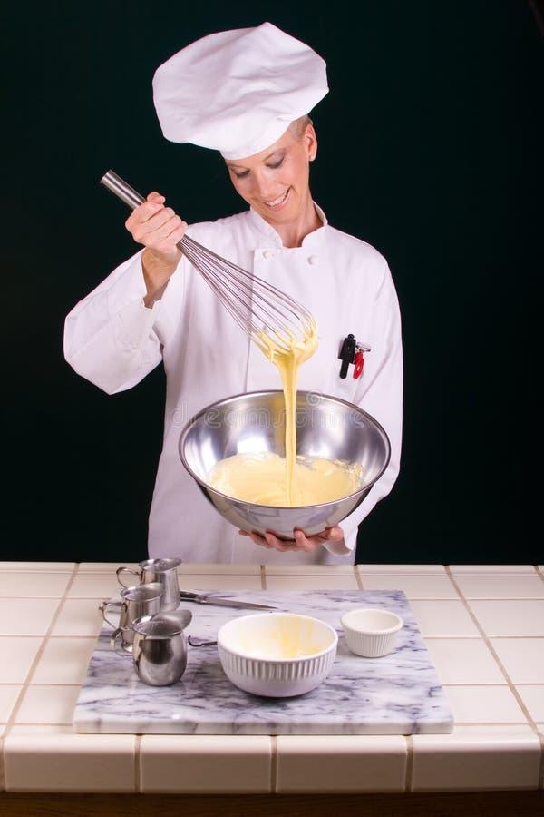 Creme Brulee Whisking royalty free stock photos