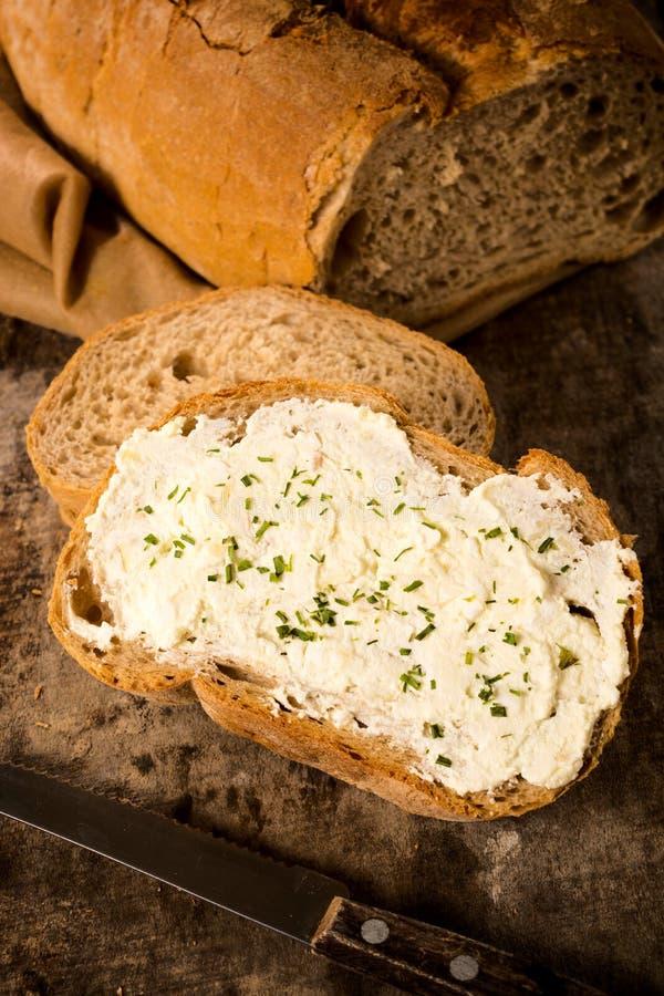 Creme do queijo no pão foto de stock royalty free