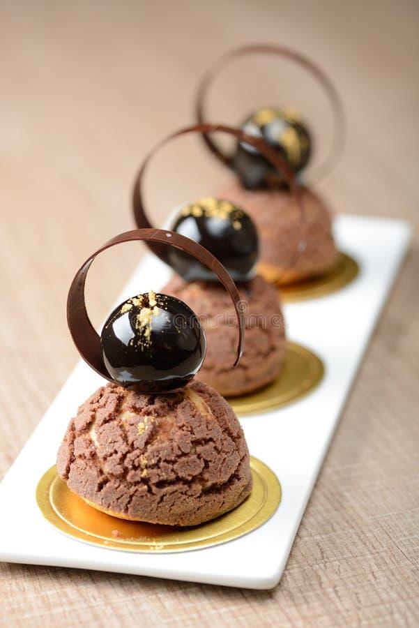 Free Cremeux Chocolate Choux Dessert Royalty Free Stock Image - 64238406