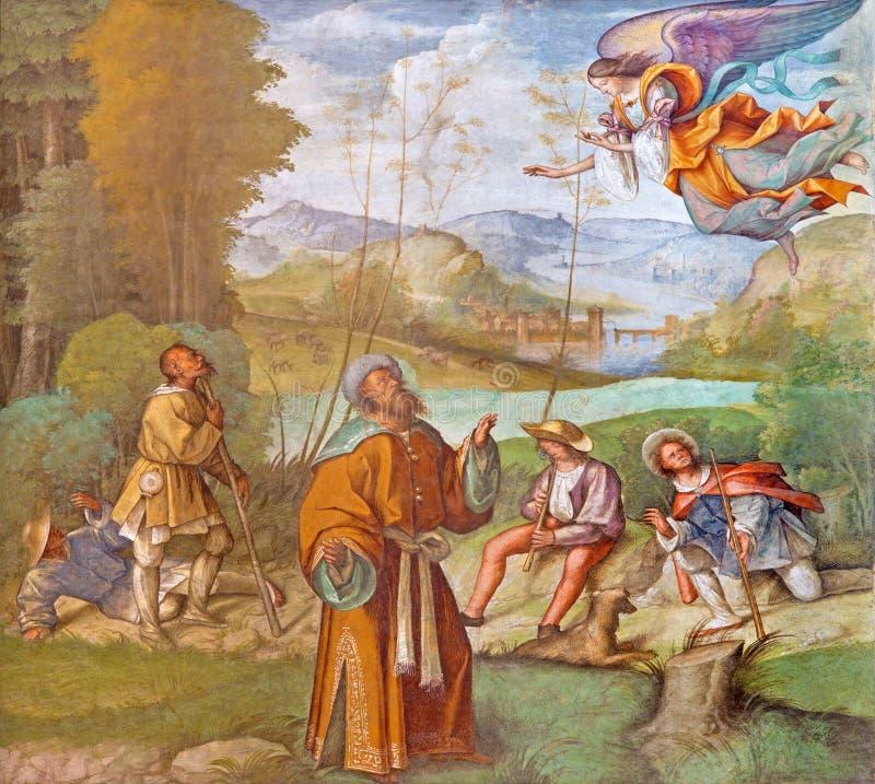 CREMONA ITALIEN, 2016: Freskomålningen av St Joachim med ängeln i domkyrkan vid Boccaccio royaltyfri fotografi