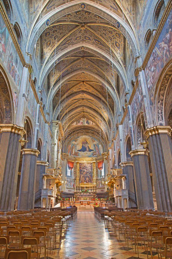 CREMONA, ITALY, 2016: The gothic nave of Cathedral with the renaissance frescoes. CREMONA, ITALY - MAY 25, 2016: The gothic nave of Cathedral with the royalty free stock image