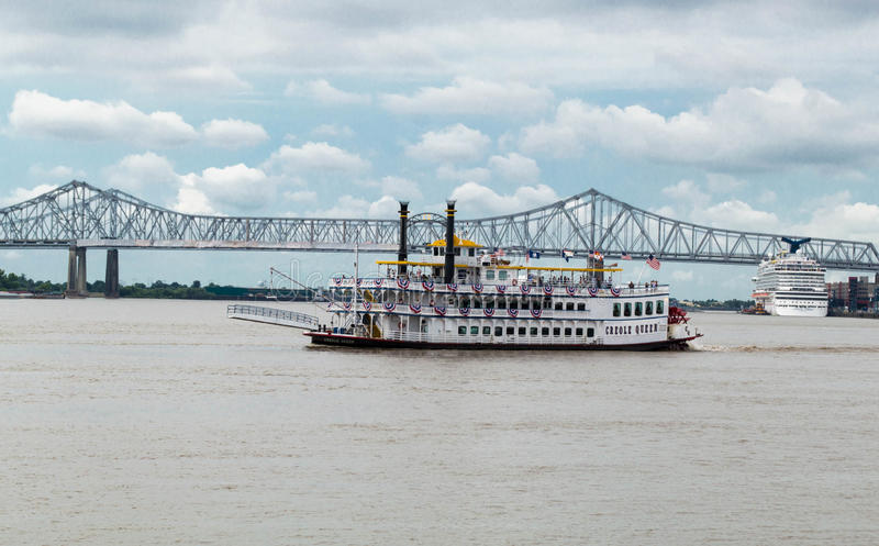 Creole Queen New Orleans Tour Boat on Mississippi River near Bridge stock images