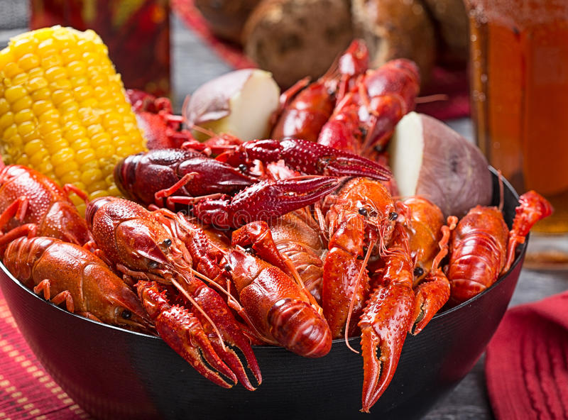 Creole style crawfish boil. Crawfish boil with corn and potato with a casual, rustic feel stock photo