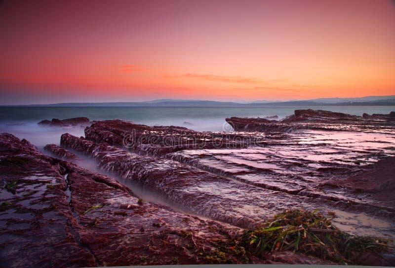 Crepúsculo no mar imagem de stock