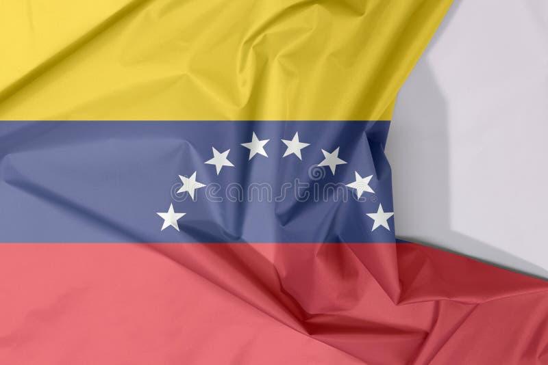 Crepe и залом флага ткани Венесуэлы с белым космосом иллюстрация штока
