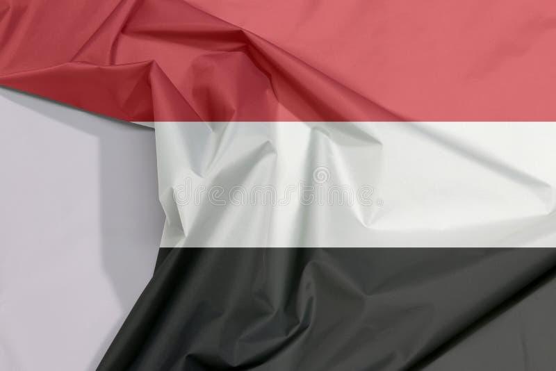 Crepe и залом флага ткани Йемена с белым космосом бесплатная иллюстрация