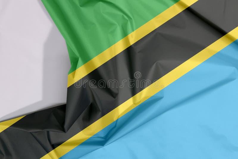 Crepe и залом флага ткани Танзании с белым космосом иллюстрация вектора