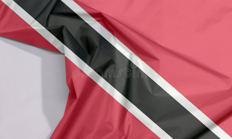Crepe и залом флага ткани Тринидад и Тобаго с белым космосом иллюстрация штока