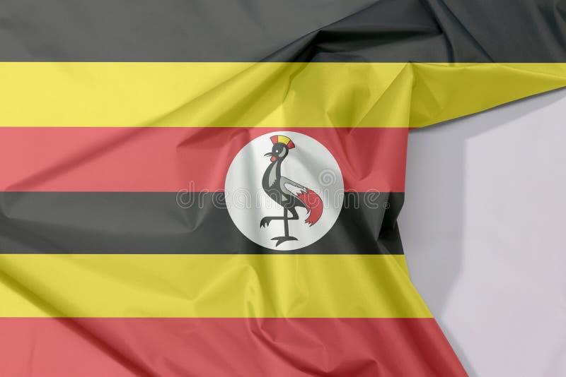 Crepe и залом флага ткани Уганды с белым космосом иллюстрация вектора