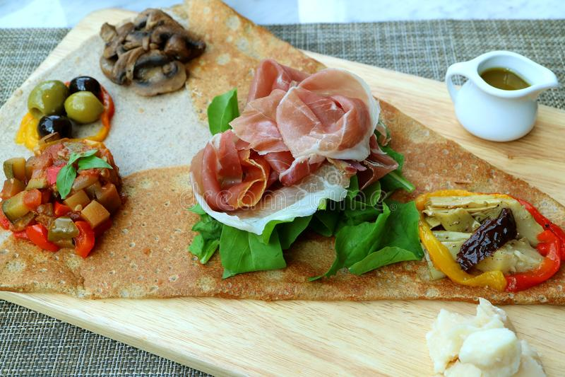 Crepe Antipasto or Crepe Appetizer with cold cuts and variety of saute vegetable stock photos