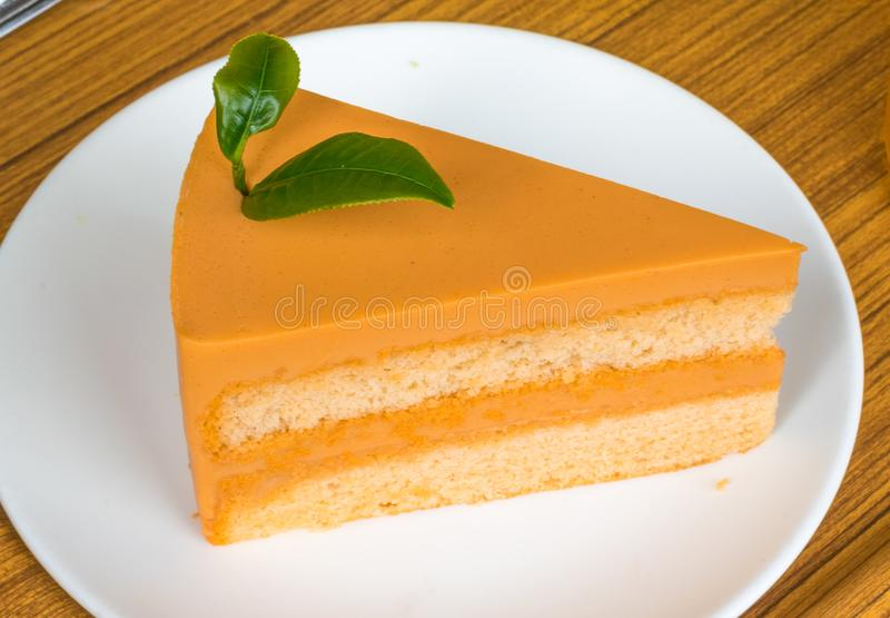 Crepe Cake. Close up Crepe Cake with tea leaves placed on top in white plate and look delicious royalty free stock image