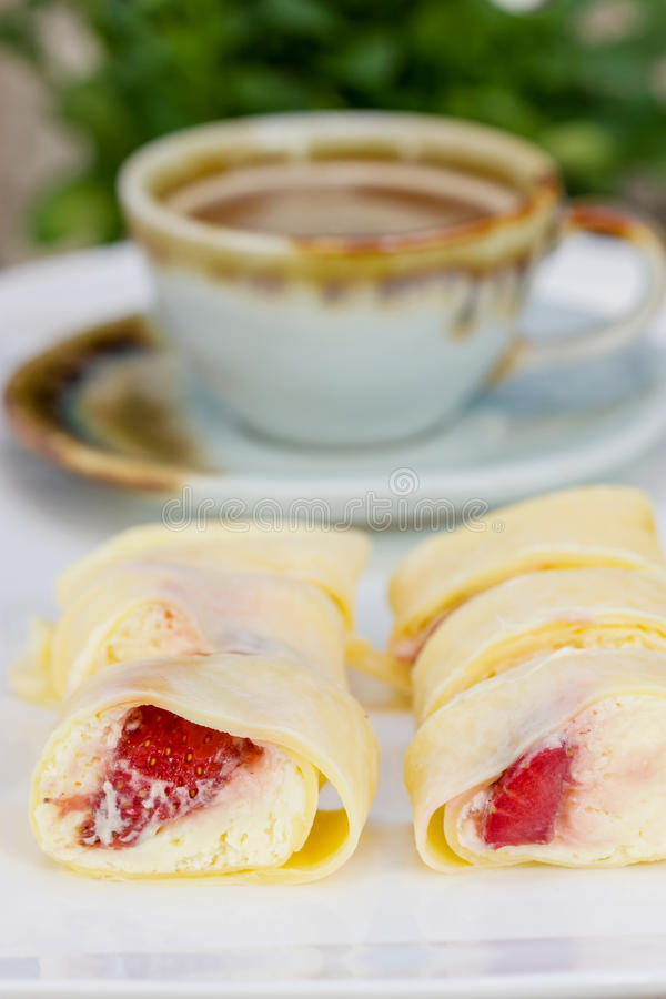 Crepe Cake strawberries. And cup of coffee royalty free stock photography