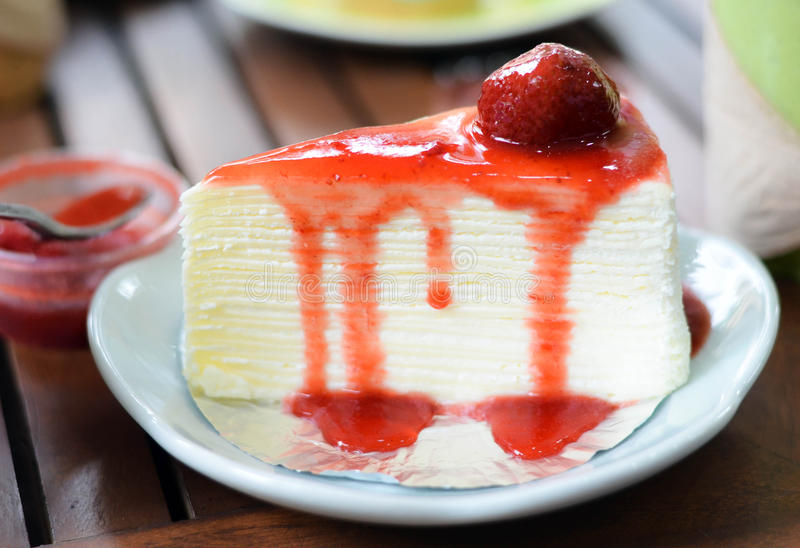 Crepe cake with strawberry sauce royalty free stock images