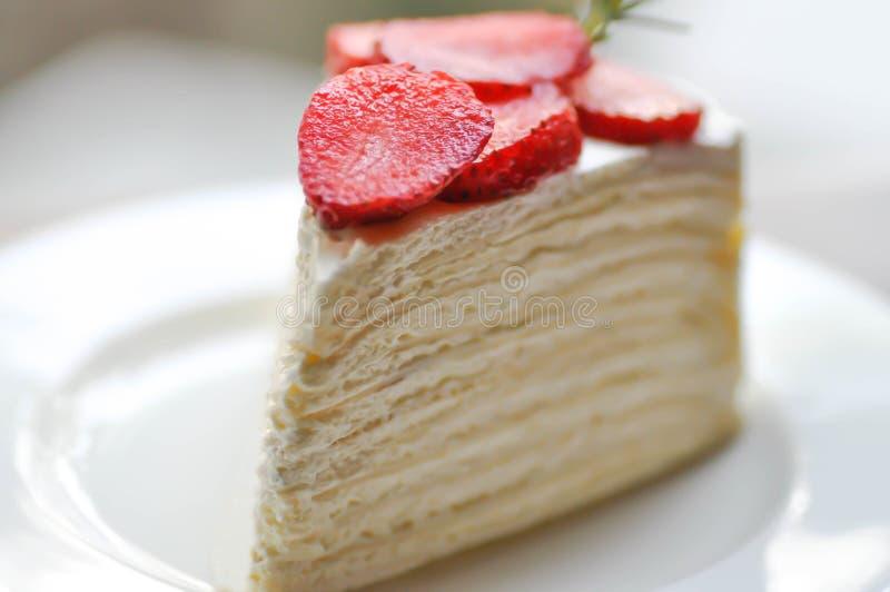 Crepe cake or strawberry crepe cake. Crepe cake with strawberry topping or strawberry crepe cake stock photo