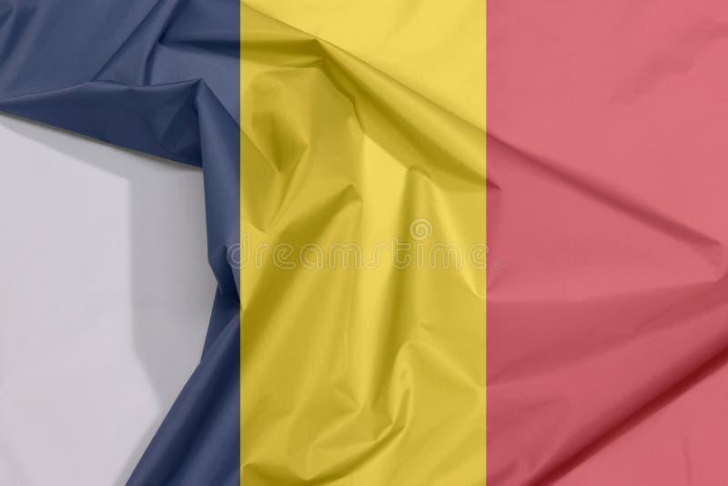 Crepe e vinco da bandeira da tela de Chade com espaço branco fotografia de stock royalty free