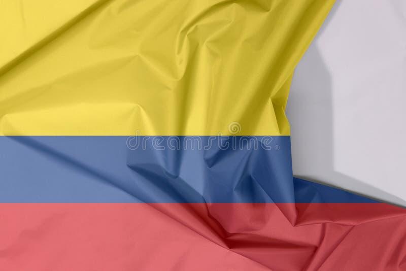 Crepe e vinco da bandeira da tela de Colômbia com espaço branco fotos de stock royalty free