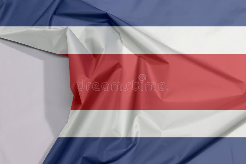 Crepe e vinco da bandeira da tela de Costa Rica com espaço branco fotografia de stock royalty free